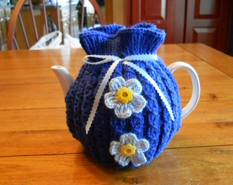 Tea Cozy Knitted in Royal Blue with Light Blue Flowers and Ribbon
