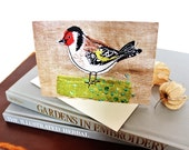 goldfinch on grass card eco