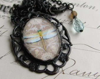 Dragonfly necklace made with Fallen Angel Brass, handmade glass cabochon, sky blue glass beads, taupe and black pendant