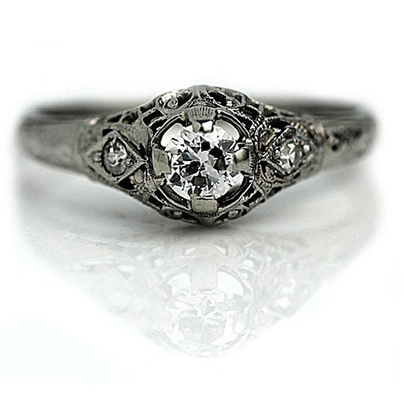 Antique engagement ring one central diamond by ArtDecoDiamonds