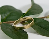 Gold Botanical Wedding Band: A 18k yellow gold textured wedding ring band
