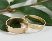 Gold Botanical Wedding Bands: A hers and hers set of18k yellow gold textured wedding ring bands