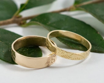 Gold Botanical Wedding Bands: A hers and hers set of 18k yellow gold textured wedding ring bands