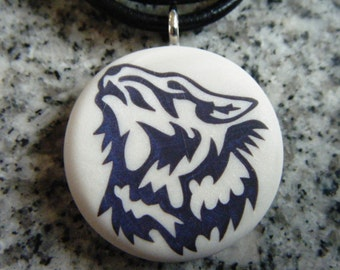 Wolf pendant hand carved on a polymer clay pearl color background.  Pendant comes with a FREE necklace.