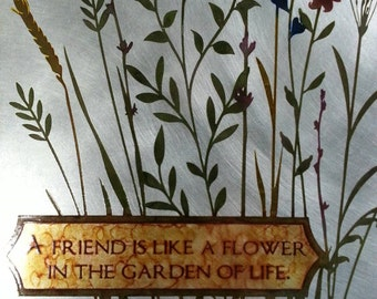 A friend is like a flower in the garden of life Etched metal sign