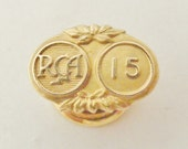 1965 fifteen  year service lapel pin RCA music company, solid gold
