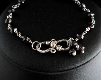 Sterling Wire Wrapped Bracelet with Hand Faceted Garnet Beads and Ornate Handmade S-Clasp