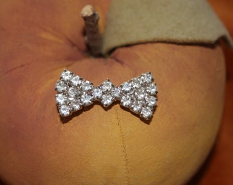 Bow tie rhinestone pin