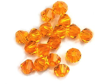 Swarovski Crystal Beads Orange Bicones 5301 4mm Beads (24)
