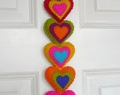 Colorful felt hearts wall hanging - stuffed (8 hearts)