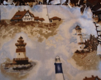 Lighthouse tied Fleece Blanket with white and blue background