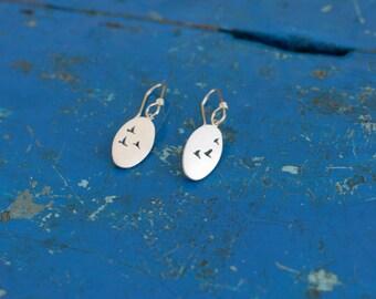 Flock of bird earrings, sterling silver oval drop earrings with bird detail