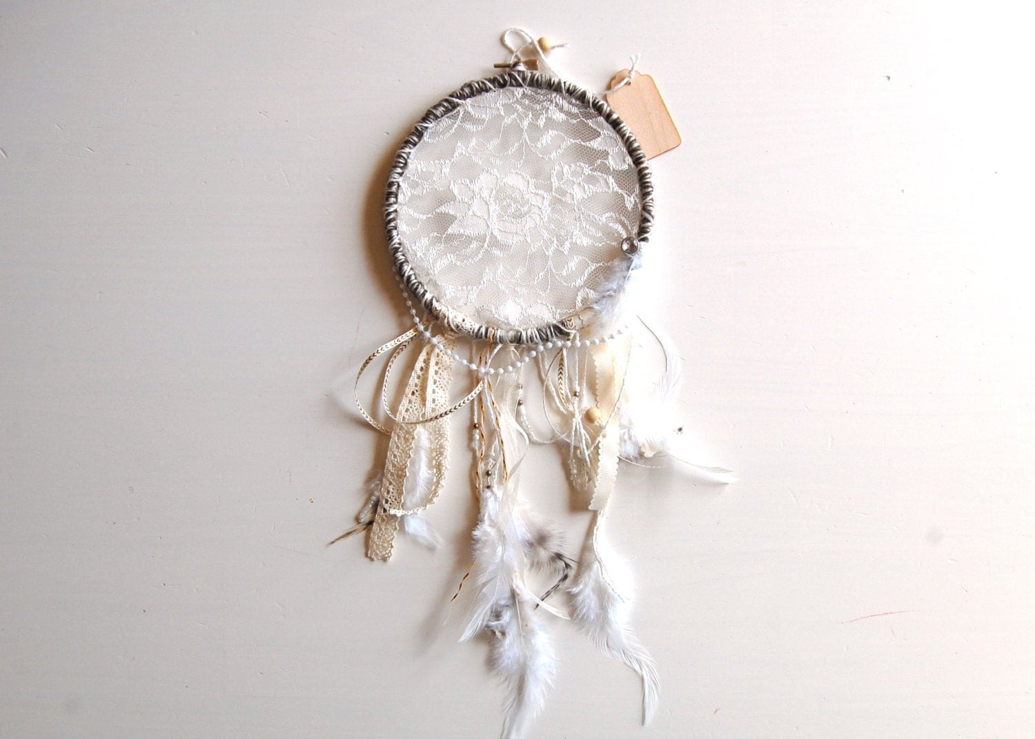 Lace dream catcher on embroidery hoop