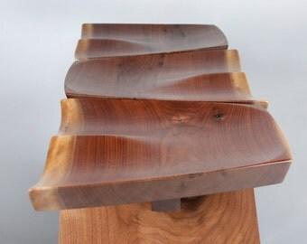 Walnut stools made in natural edge wide plank walnut.
