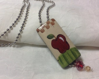 Hand painted apple pendant with a ball chain