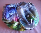 SassyCloth one size pocket diaper with smoke and mirrors PUL print. Made to order.