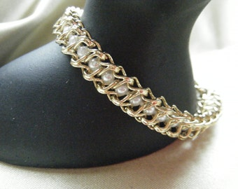 Gold tone Link Bracelet with Entwined Pearls