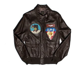 Vintage Willis and Geiger Leather A-2 Bomber Jacket with Patches for a Men's Size 38