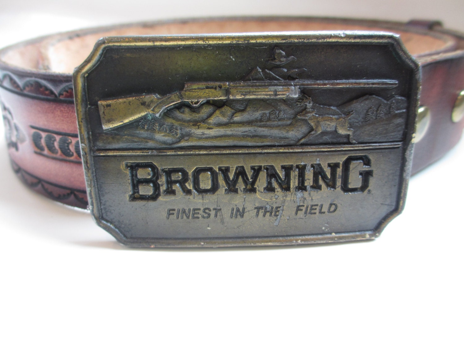 vintage browning belt buckle and tooled leather by