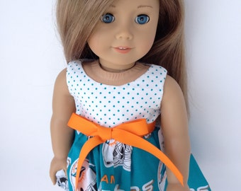 18 inch game day dress made from   Miami Dolphin fabric, made to fit  18 inch dolls such as American Girl and similar 18 inch dolls.
