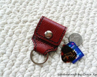 100% hand stitched handmade dark red cowhide leather guitar pick/ SD card/  golf ball marker holder/ keychain with a Fender Celluloid pick