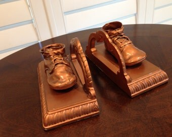 Bronzed baby shoes bookend heavy metal with bronze vintage overlay