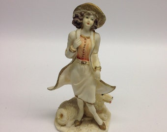 Vintage figurine-sculpture a woman and her white shepard husky in resin 5 inch Gift for her