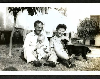 The Perfect little Happy  FAMILY Mom Pop DOG & One BABY black and white Vintage Photo laying out in the yard for portrait