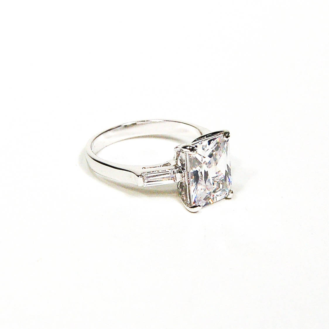 cubic zirconia engagement ring emerald cut baguettes white