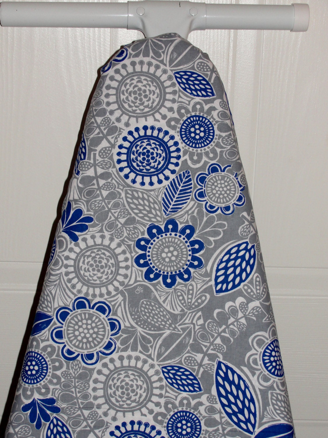 grey and yellow ironing board cover