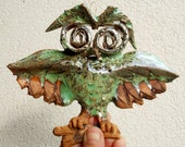 Cute little owl  Hanging on the wall owl . Fun art.  Symbol of wisdom.