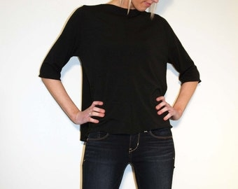 Black Semi Sheer Loose Top with Center Front and Center Back Seam and Mid Sleeves and Uneven Hemline