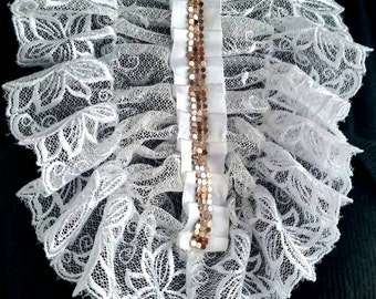 White lace jabot, romantic frill with the decoration. Necktie, necklace. Lace accessory.