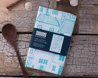 Coastal Cottages tea towel - designed by Jessica Hogarth and printed in the UK. Architectural illustration screen printed on to fabric