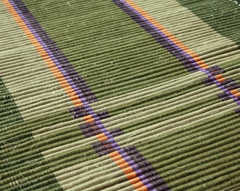 24 x 36 Handwoven cotton rug in olive and khaki with orange and purple.