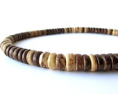 Men's wooden necklace made from brown coconut shell - Woodsman
