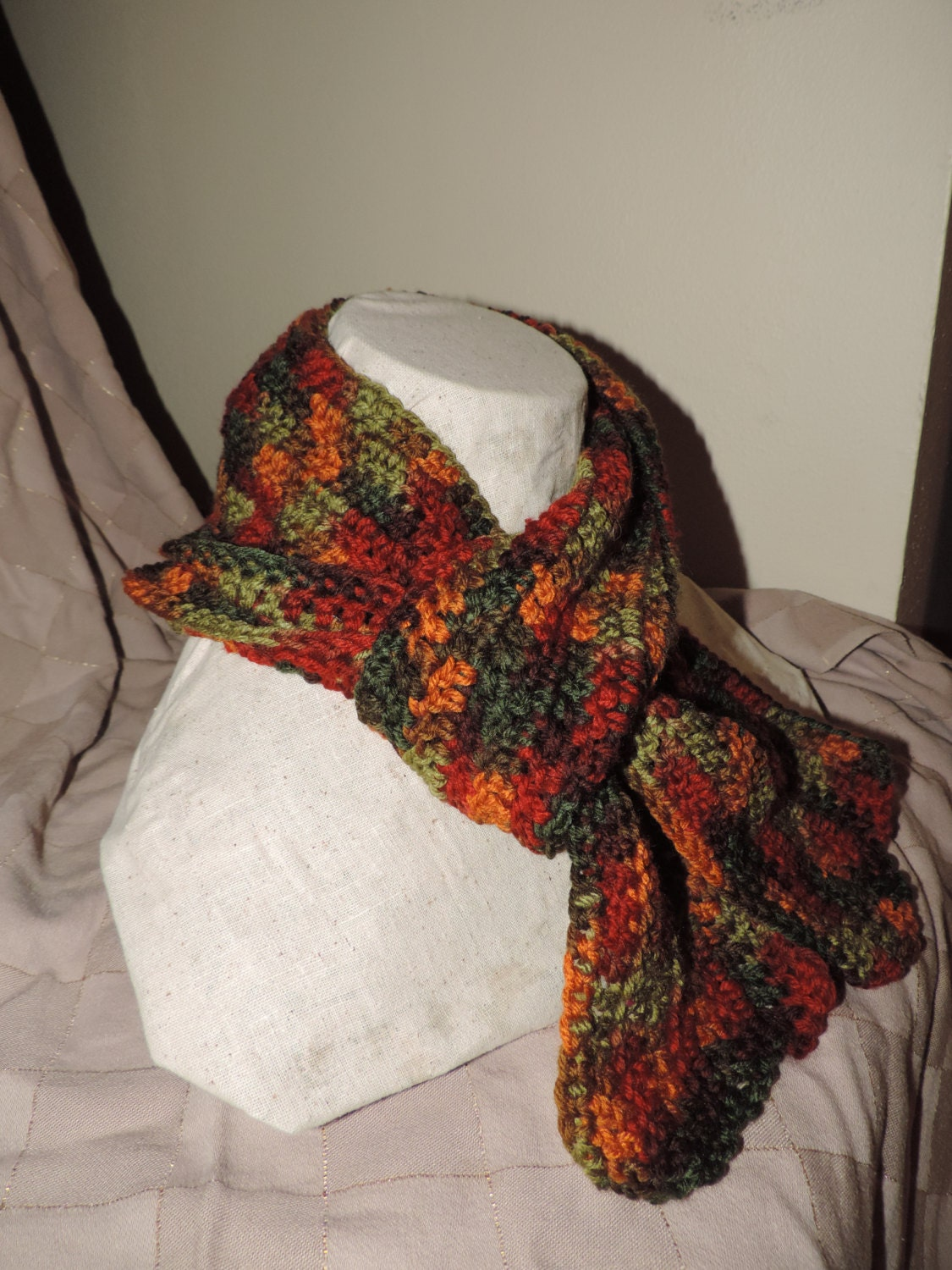 Crochet scarf dark green and multi color synthetic yarn.