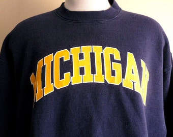 Go Wolverines vintage 80's 90's University of Michigan varsity graphic sweatshirt navy blue crew neck fleece pullover white yellow gold logo