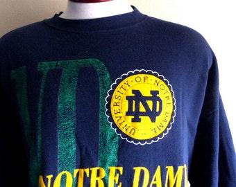 Go Fightin' Irish vintage 80's 90's UND University of Notre Dame navy blue fleece yellow green puffy print logo graphic sweatshirt crew neck