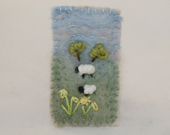 Embroidered Brooch - Daffodils and sheep on Felted background