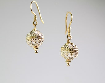 Silver drop earrings featuring contrast gold beads.