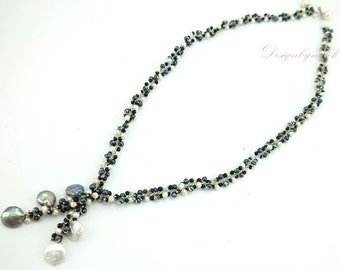 Black and white freshwater pearl on silk long necklace.