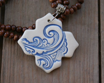 Light Blue Wave ceramic pendant necklace with brown wooden beads