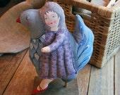girl riding a bird, painted folk art doll - soft sculpture