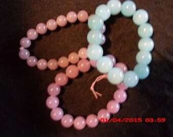 3 glass bead stretch bracelet 2 purple and 1 green.