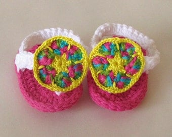 Hand crocheted flip flops baby sandals with African flower toe embellishment