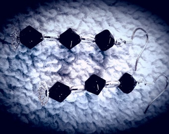 Black and silver dangle earrings.