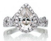 14 Karat Gold 9x6mm Pear Shape Moissanite Diamond Halo Twist Infinity Shank Design Engagement Gemstone Anniversary Ring