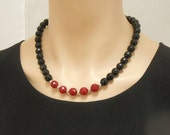 Faceted black onyx and red jade necklace with matching earrings
