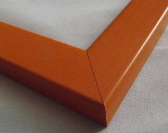 11 x 14 Ready to ship Picture Frame ~ Flat profile with rounded edges ~ Orange ~ 1 inch wide x 5/8 inch tall x 3/8 inch deep Moulding